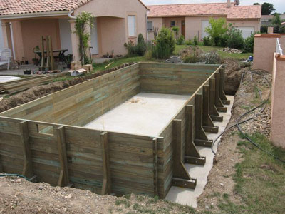 Montage piscine bois for Piscine encastrable bois